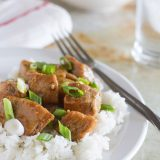 Asian Slow Cooker Pork Roast - Boneless pork roast is slow cooked in a sweet Asian-inspired sauce and then served over rice in this slow cooker pork roast recipe.