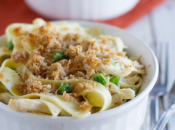 This Garlic Parmesan Chicken Pasta is made easy by using precooked, shredded chicken. A garlic parmesan sauce coats the chicken and homestyle noodles in this fast and comforting casserole.