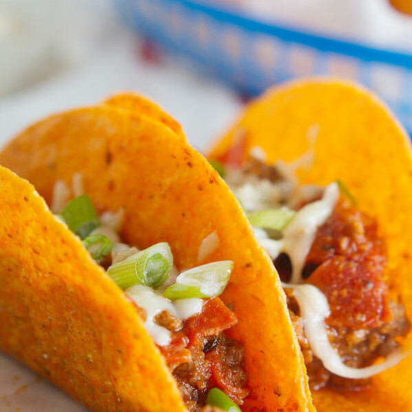 Meat Lovers Pizza Tacos - Cheesy taco shells are filled with a meaty mixture of ground beef, sausage and pepperoni with pizza sauce in these tacos that are perfect for Meat Lovers Pizza lovers.