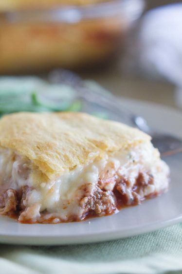 A play on lasagna, this Mock Lasagna is an easy weeknight dinner with ground beef, lots of cheese and crescent rolls is a family favorite.