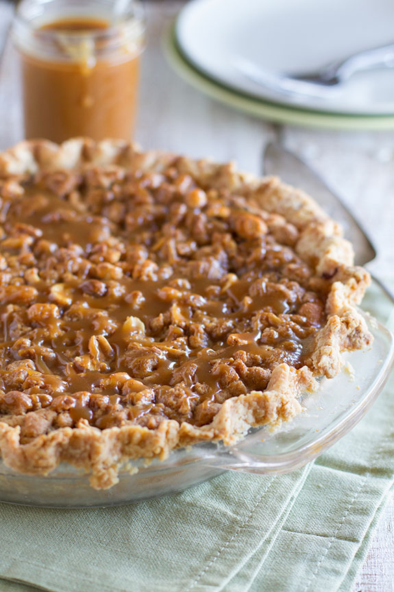 Peanut Butter Fudge Pie with Salted Peanut Butter Caramel - this pie has it all - fudge, a peanut butter crumble and then a delicious salted peanut butter caramel.