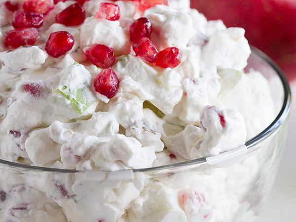 Jazz up that fruit salad recipe with this Apple Pomegranate Salad that has sweetened whipped cream with apples, marshmallows, and lots of fresh pomegranate seeds.