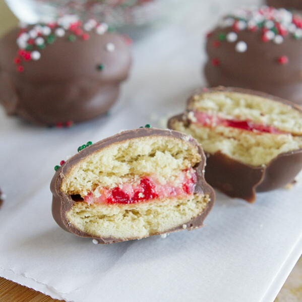 Chocolate Cherry Sandwich Cookies - Vanilla wafers are filled with a cherry cream cheese mixture, then dipped in chocolate in these fun cookies.