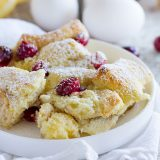 Cranberry Orange Baked French Toast Casserole - this overnight casserole is filled with cranberry and orange flavors.