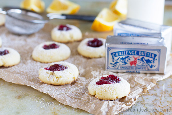 Cranberry Thumbprint Cookie Recipe - Orange scented cookies are topped with a dollop of cranberry sauce in these festive cookies.