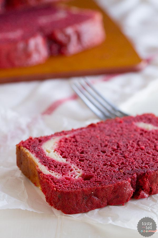 A red velvet quick bread with a cream cheese filling on www.tasteandtellblog.com
