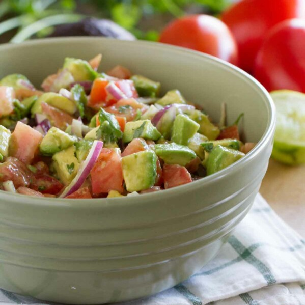 Fresh and bright, this Avocado and Tomato Salad is a perfect side dish alongside any Mexican themed meal. It's also a great pot-luck salad!