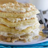 Pancakes for dessert!! These fluffy Cheesecake Pancakes are topped with a cream cheese frosting and graham cracker crumbs for a fun and delicious treat.