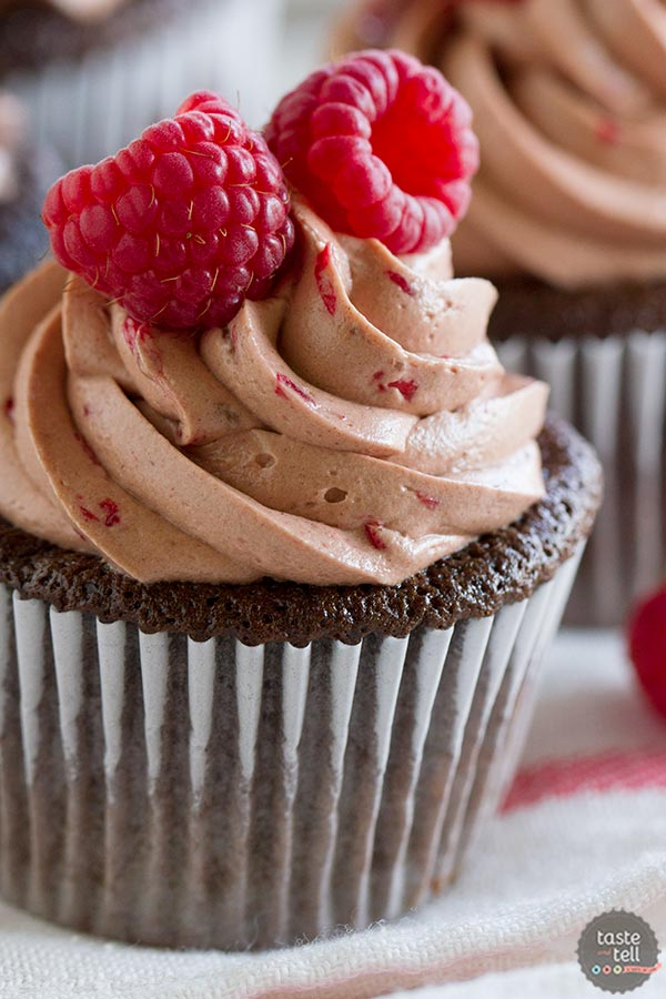 Silky smooth Raspberry Chocolate Buttercream on top of Chocolate Cupcakes with Raspberry Filling