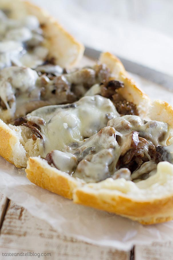 French bread is topped with cooked sausage, portobello mushrooms and cheese in this easy French bread pizza recipe.
