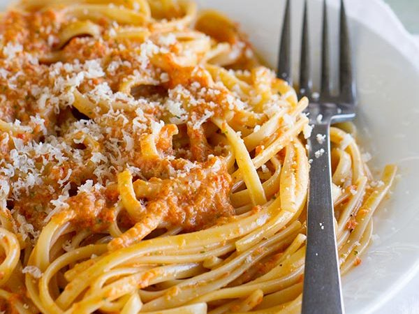 A roasted red pepper pesto is the star in this easy vegetarian pasta dinner. This Roasted Red Pepper Pesto Linguine is easy enough for a weeknight, but fancy enough for a special dinner.