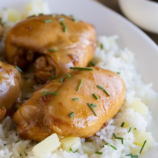 Boneless chicken thighs are coated in a sweet asian-inspired sauce and served over sweet pineapple rice in this Sweet Asian Chicken with Pineapple Rice.