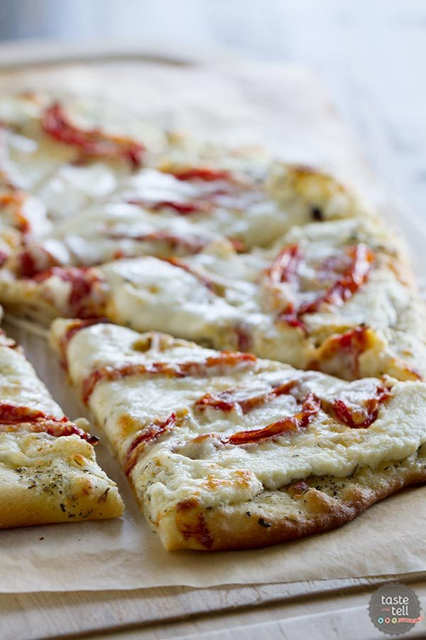 Pizza crust is covered with an herb oil, then ricotta, lots of sweet roasted tomatoes and mozzarella cheese in this White Pizza Recipe with Roasted Tomatoes.