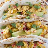Eat your tacos for breakfast with these breakfast tacos filled with scrambled eggs with onions, jalapeños, tomatoes and crumbled tortilla chips. Migas Breakfast Tacos are a great way to add a little Tex-Mex to your morning!