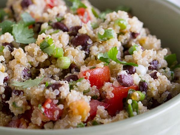 Healthy and satisfying, this Tomato and Black Bean Quinoa Salad is perfect for a pot luck or for a delicious side dish.