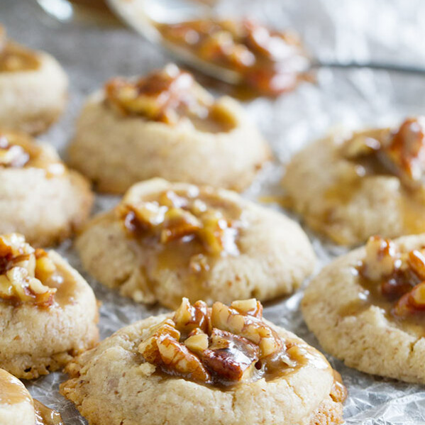 Salty and sweet, these Pecan Praline Thumbprints are pecan infused cookies topped with a sweet and salty pecan praline topping. Also a review of Cookie Love by Mindy Segal.