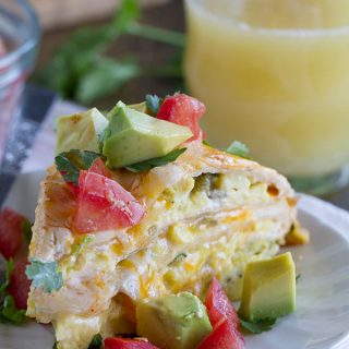 This Breakfast Tortilla Stack has flour tortillas that are layered with scrambled eggs with green chiles, a sour cream sauce and cheese for a breakfast dish that is perfect for breakfast, lunch or dinner!