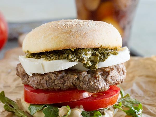 Summer in a burger, this Caprese Burger has all the flavors of a Caprese salad - mozzarella, tomatoes and basil. Plus a review of The Art of the Burger by Jens Fischer.
