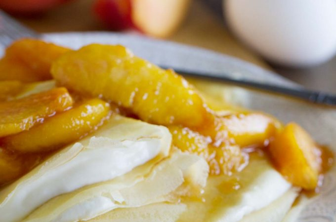 Easy to make Crepes topped with peaches and filled with cream cheese