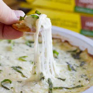 Hot and cheesy and totally addictive - this White Cheese Dip is the perfect addition to any pizza night at home!