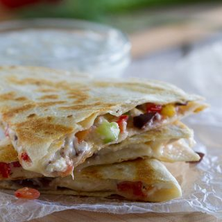 All of your favorite Greek flavors in a cheesy tortilla! These Greek Quesadillas are great for lunch or an easy vegetarian dinner.