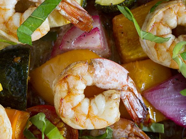 A great way to use up the summer vegetables, this perfect summer dinner is done in a snap with minimal clean up with this Sheet Pan Balsamic Shrimp and Summer Vegetables.