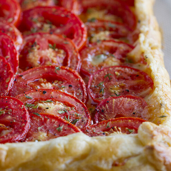 Perfect as a light supper or as a side dish, this Tomato Tart with Bacon and Gruyere is as tasty as it is beautiful!