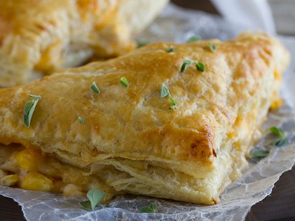 Chicken, corn, cheese and an easy cream sauce are enclosed in puff pastry triangles to make this Creamy Chicken and Corn Turnover Recipe that will be a hit with the family.