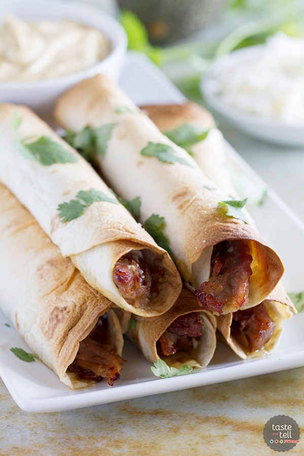 Pork gets slow cooked in a sweet and spicy sauce and then turned into an easy dinner with these Slow Cooker Sweet Pork Baked Taquitos.