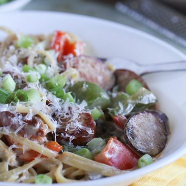 You'll never know that this Lighter Cajun Sausage Pasta has less calories than most creamy pastas! A secret ingredient helps to make this dish lighter, yet it is still creamy and full of flavor.