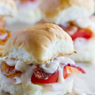 A riff off of the popular open-face sandwiches served at the Brown hotel near the Kentucky Derby racetrack, these Mini Hot Brown Sliders are a tasty and fun dinner or lunch idea.