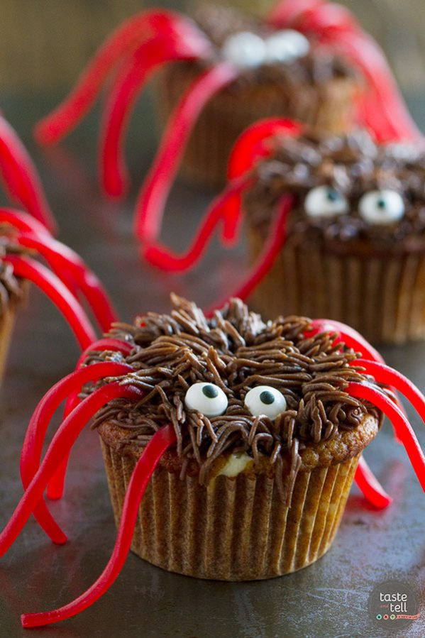 Pumpkin cupcakes are filled with a cheesecake center, and then decorated as spiders for this perfect Halloween dessert. These Pumpkin Cheesecake Cupcakes are scarily delicious!!