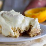 Mashed sweet potatoes make these rolls super tender and soft and the orange cream cheese glaze takes these Sweet Potato Cinnamon Rolls with Orange Cream Cheese Frosting to a new level!