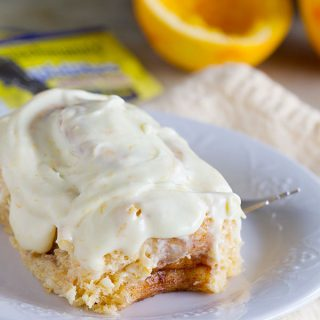 Mashed sweet potatoes make these rolls super tender and soft and the orange cream cheese glaze takes these Sweet Potato Cinnamon Rolls with Orange Icing to a new level!