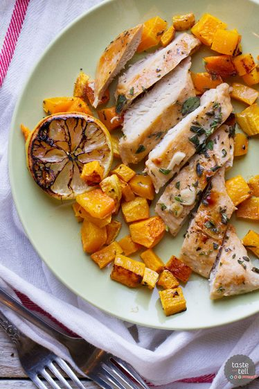 Simple and healthy, this Easy Lemon Chicken with Butternut Squash serves up roasted chicken breasts doused in lemon juice over roasted butternut squash.