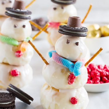 It doesn't get more fun than these cute snowmen that are a great way to celebrate winter! Rolls are lightly flavored with orange, then stacked into snowmen that get a creamy, orange glaze. A few decorations make these Orange Snowman Rolls a fun, and delicious, activity the whole family will love.