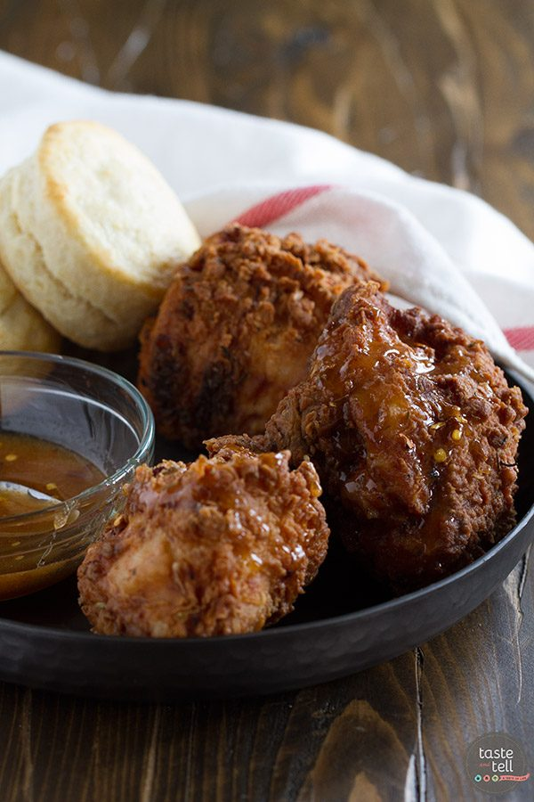 Get ready to have your mind blown - this Honey Fried Chicken with Hot Honey Sauce and Biscuits just may be the moistest, most delicious fried chicken recipe you've ever had. Served up with buttermilk biscuits and a sweet and spice Hot Honey Sauce, this is one recipe that is sure to impress.
