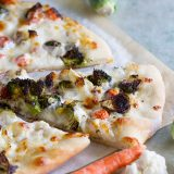 Have a veggie drawer filled with vegetables that are just past their prime? No need to toss them - roast them up for this delicious Roasted Vegetable Pizza with Ranch!