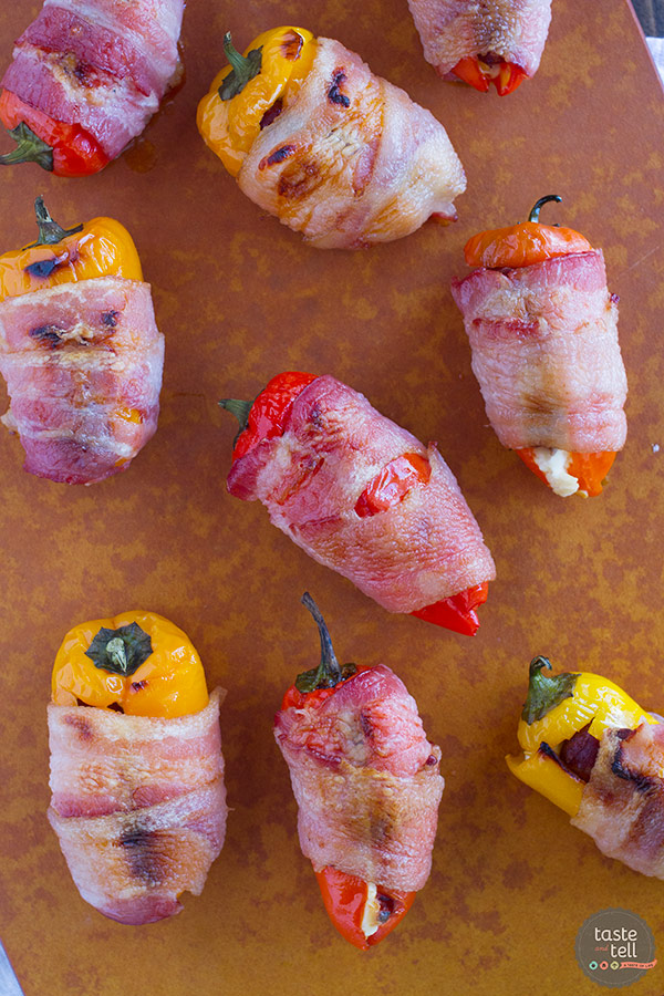 These Sausage Stuffed Peppers have mini peppers that are stuffed with cream cheese and mini smoked sausages, and then are wrapped in bacon for a bite-sized appetizer that will be a total crowd pleaser.