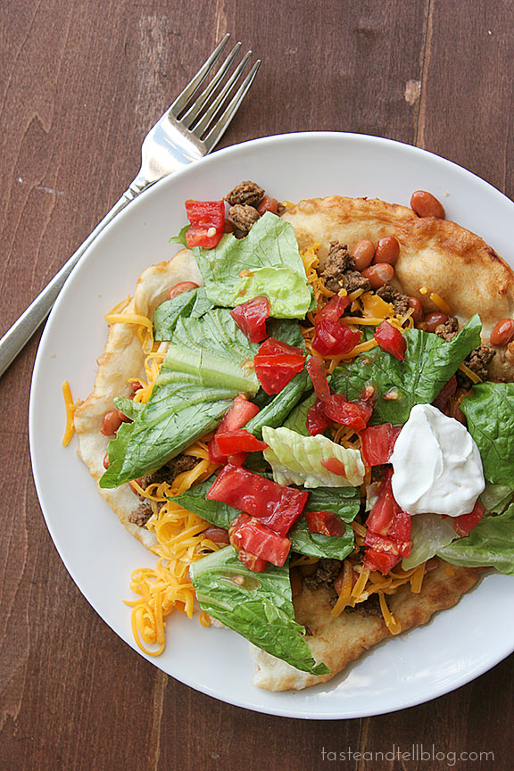 A version of a traditional Navajo Taco - fry bread topped with meat, beans, cheese, lettuce and tomatoes. Save any leftover fry bread to eat with honey for dessert!
