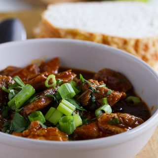 Tender chunks of pork are bathed in a rich chili sauce in this New Mexican Red Pork Chili that will leave you licking your bowl clean.