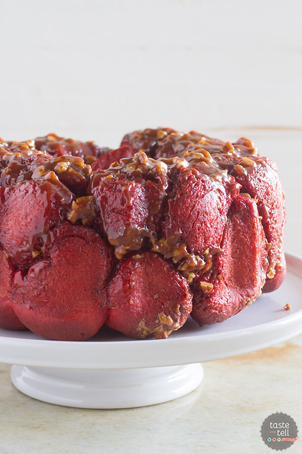 Soft and gooey and a vibrant red, this Red Velvet Pull Apart Bread is perfect for breakfast or for a delicious dessert. Layers of red velvet dough are covered in a gooey cinnamon pecan mixture. Don't skip the cream cheese icing to top the whole thing off!