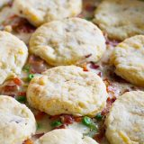 What can be better than a creamy chicken and bacon pot pie, topped with bacon cheddar biscuits? It is said that bacon makes everything better, and this Chicken and Bacon Pot Pie with Bacon Cheddar Biscuits is proof that it is true!