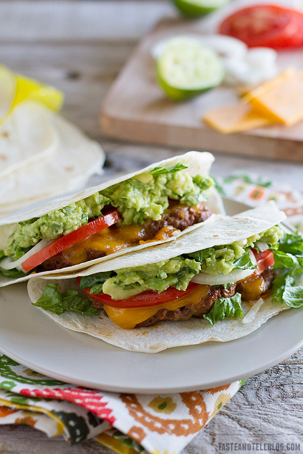 Cheeseburger meets Tex-Mex meets taco night in these taco spiced cheeseburgers that are served taco style.
