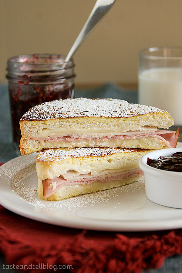 A traditional Monte Cristo Sandwich -a turkey, ham and cheese sandwich served between 2 slices of French toast, dusted with powdered sugar and served with raspberry jam.