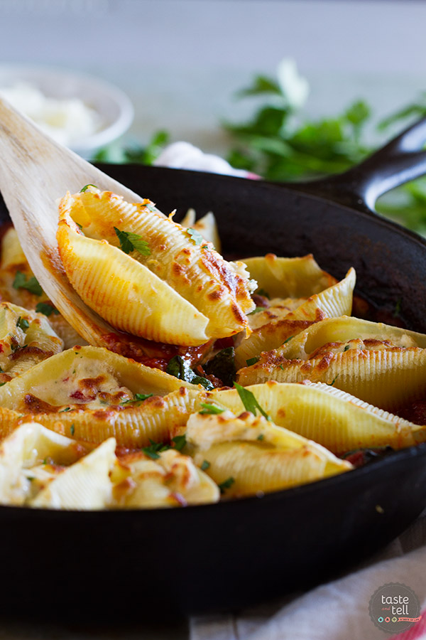 Dinner is served! These Stuffed Pasta Shells with Easy Bolognese Sauce look like they take a lot of time and effort, but the recipe comes together quickly enough for a weeknight dinner!