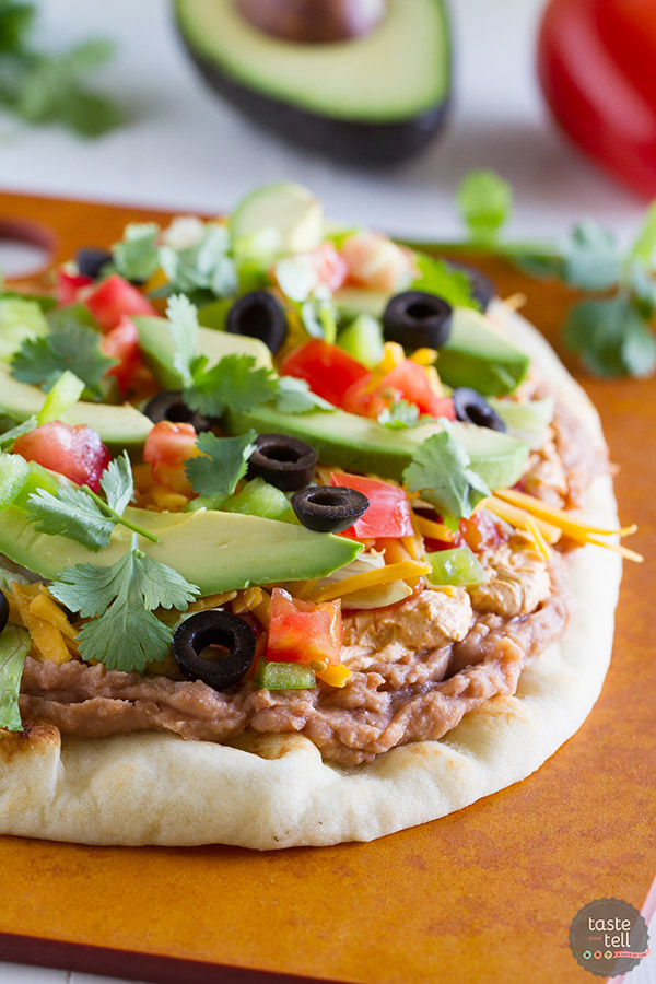 Looking for a fast, easy appetizer or main dish? This 7 Layer Flatbread Recipe takes a favorite dip and turns it into a hearty dish that is perfect for a party.