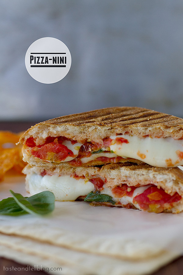 It's a pizza panini! This panini recipe has a homemade tomato sauce that is combined with cheese and pepperoni and grilled inside a sandwich for an easy meal both sandwich and pizza lovers will enjoy.
