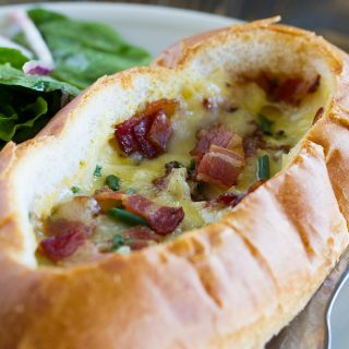 Perfect for breakfast or brunch, these Baked Egg, Bacon and Cheese Boats are a cinch to throw together and are filling and delicious.