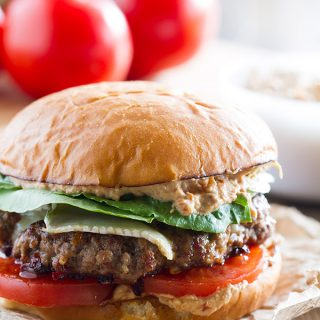 Burgers go gourmet with this Brie Burger with Sun-Dried Tomato and Artichoke Spread. A flavorful burger patty is topped with melty brie cheese, and the sun-dried tomato and artichoke spread gives this burger a wow factor!